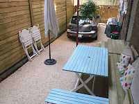 Making the best of what you have to work with. An unused space is transformed into a driveway and patio area.