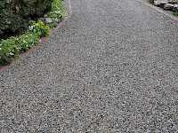 CORE Gravel grids retain the gravel and ends rutting and sinking on a gravel driveway. It is also weed free and allows for landscaping right up to the driveway's edge.