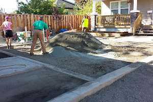 Volunteers prepare the parking area for a CORE Gravel installation.