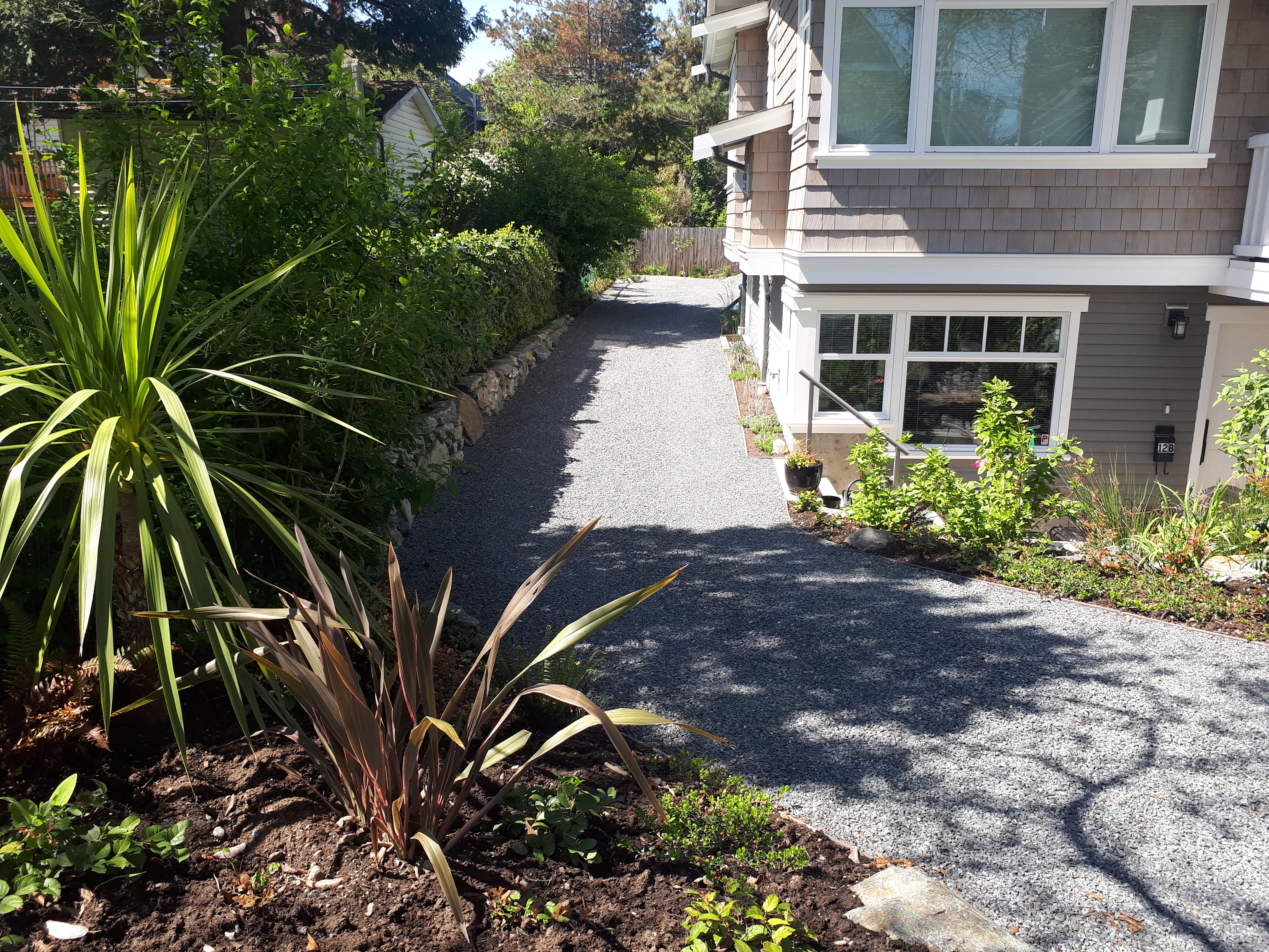 Green Driveway Stabilized and Porous Gravel and Grass